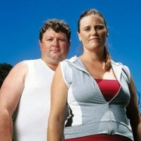 kövér házaspár sportruhában, kövér, elhízás